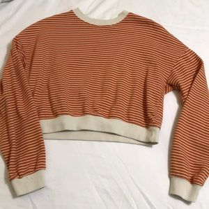 Orange and white striped cropped sweater